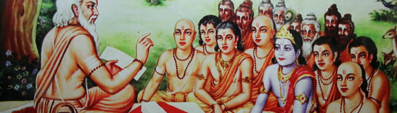 insegna in una classe con Shri Krishna e Balarama
